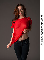 Redhead - Pretty pale redhead in a red blouse and jeans
