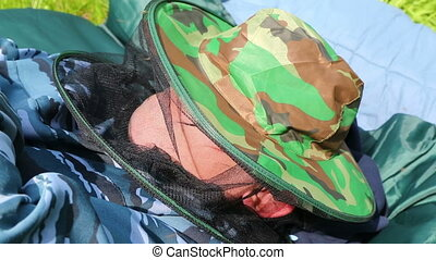 mosquitoes sit on a mosquito net hat sleeping man