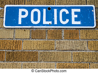 Police Station sign on brick wall in horizontal orientation...
