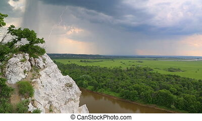 landscape with river and rain on horizon - view from height