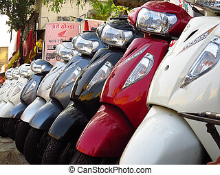 Suzuki Scooters for sale next to a Honda shop in India -...