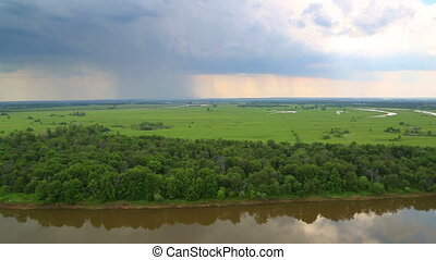 timelapse landscape with river and rain on horizon - view from height