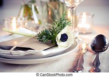 Holiday table setting with white flowers and candles
