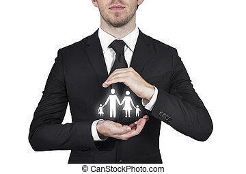 businessman protecting family paper cut