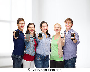students showing blank smartphones screens - education and...