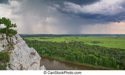 timelapse landscape with river and rain on horizon - view...