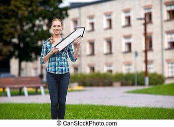 smiling young woman with arrow poiting up