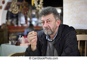Smoking issues - Adult caucasian man with beard smoking...
