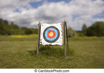 Archery target - A single archery target against a cloudy...