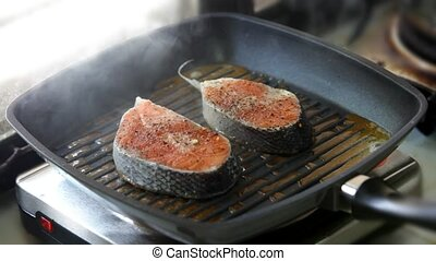Cooking salmon steaks on the grill pan and lay out on Cooking salmon steaks on the grill pan