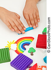 Child hands with modelling clay - closeup