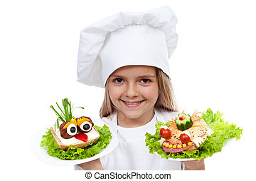 Happy smiling chef kid with creative sanwiches - Happy...