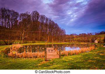Dramatic sunset sky over a pond in rural York County, Pennsylvan