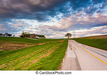 Country road and church on top of a hill in rural York County, P