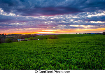 Sunset over farm fields in rural York County, Pennsylvania.
