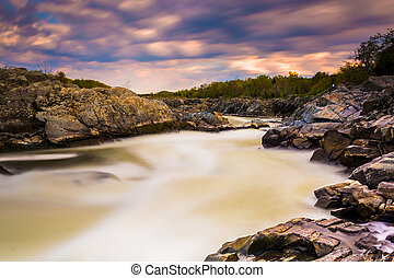 Long exposure of rapids at sunset on the Potomac River at...