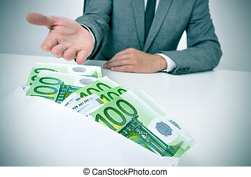 man taking an envelope full of euro bills