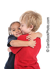 Best friends - a young boy and girl are hugging