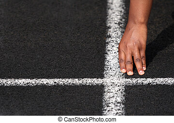Starting line - a close up of a hand on the starting line of...