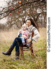 Mother with her daughter in autumn nature - Happy young...