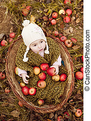 Happy little girl in basket - Happy little girl in warm...