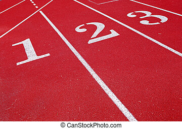 Lanes 123 on a running track - a close up of a red track...
