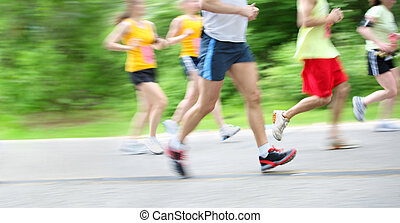 Marathon in camera motion blur - motion blur of runners in a...