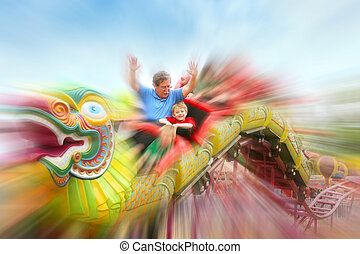 Riding the rollercoaster at the fair - a father and son on a...