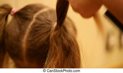 hairstyle - Mom makes daughter hairstyle
