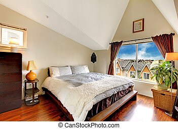 Nice bedroom with vaulted ceiling, hardwood floor and...