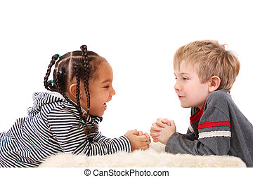 Best friends - A young boy and girl laughing at each other