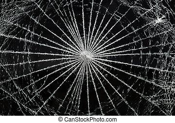 Broken Glass - a close up of a window that was broken