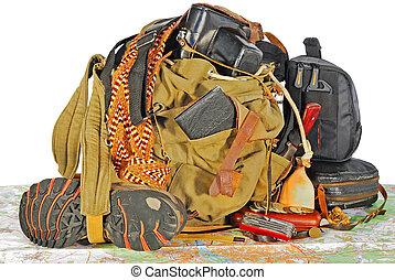 old traveller equipment : backpack, passport, knife, map,...