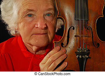 portrait of elderly woman is in red with an age-old violin