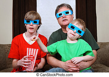 Family watching a 3d movie