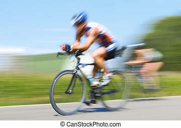 Racing bicycles, motion blur - motion blurred bicyclists...