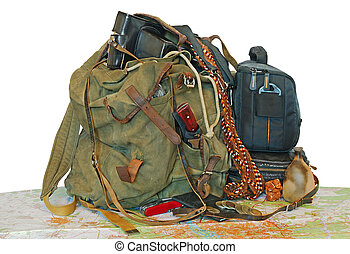 old traveller equipment. backpack, passport, map, camera ets