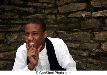 Man in front of wall smiling
