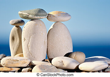 Trio - Three small stones balancing on long cobblestones