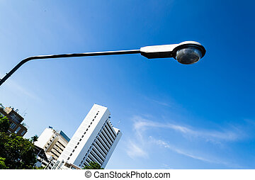 street lights in the city with blue sky