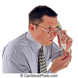 man in glasses with a telephone