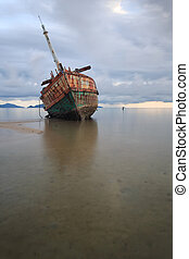 Abandoned ship with blue sky