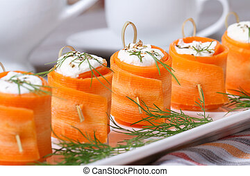 appetizer of fresh carrot rolls with cream cheese - Unusual...