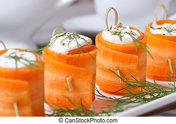 useful appetizer carrot rolls with cheese closeup - useful...