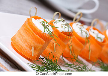 Rolls of fresh carrots with soft cheese on the table - Rolls...