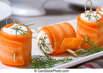 Rolls of fresh carrots with cheese and dill macro - Rolls of...