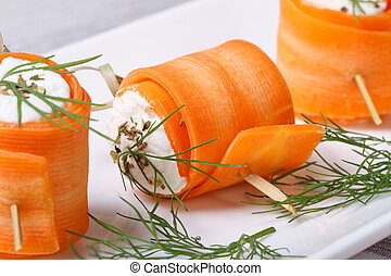 Rolls of young carrots with cottage cheese macro - Rolls of...
