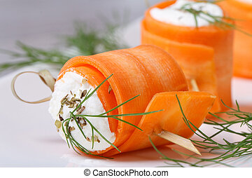 Gourmet rolls of young carrots with cream cheese macro -...