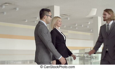 Welcoming Handshakes - Slow motion of four business partners...