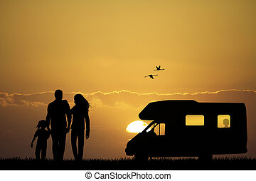 Family camping with caravan
